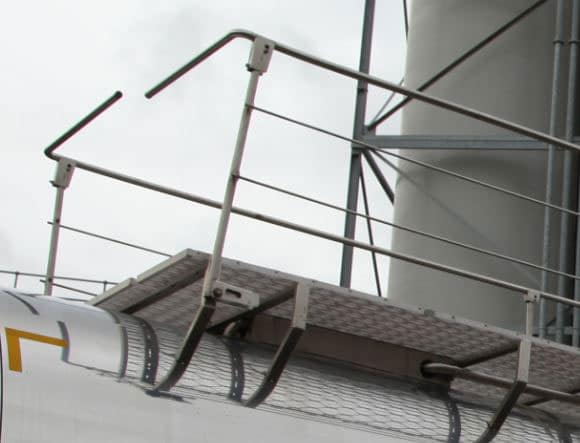Catwalk with twin ground level operated Handrails